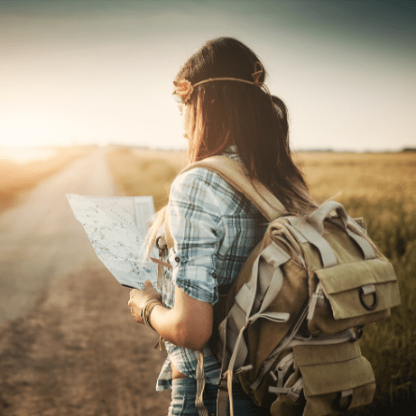 inlingua Andorra blogpost young girl backpacker with map Why go backpacking at least once in your life?