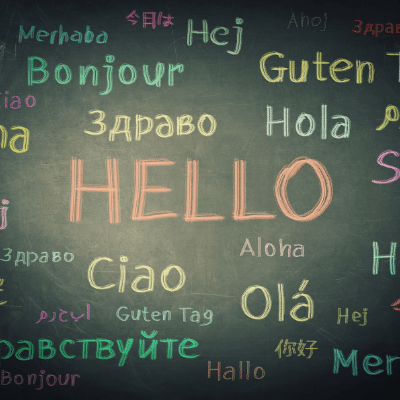 """The importance of learning a languageblogpost balckboard with the word """"hello"""" written in many different languages"""