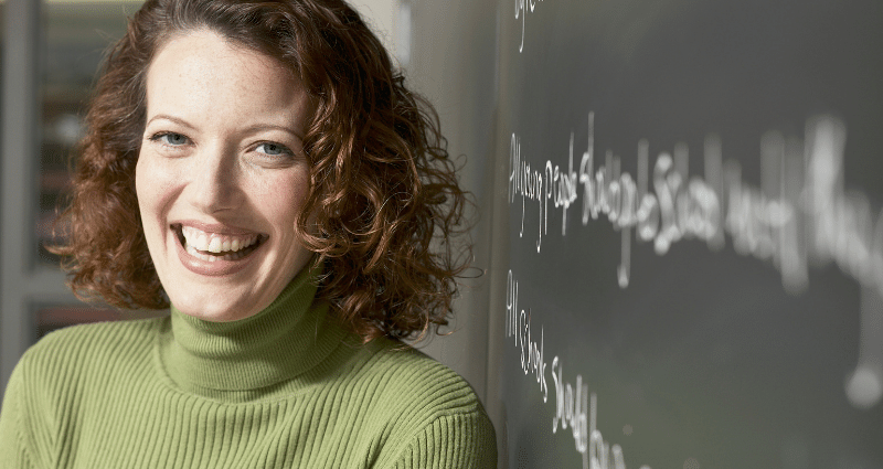 Female teacher in front of blackboard - inlingua Andorra language school in Andorra