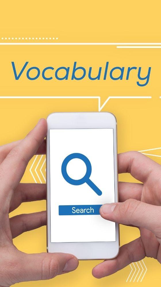 """Persona que té el telèfon a les mans amb la paraula """"Vocabulari"""" a sobre del telèfon"""
